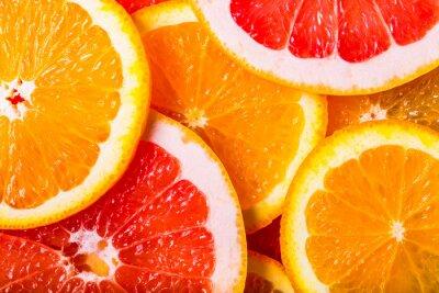 Naklejka grejpfruty i pomarańcze tle