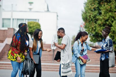 Naklejka Group of five african college students spending time together on campus at university yard. Black afro friends studying. Education theme.