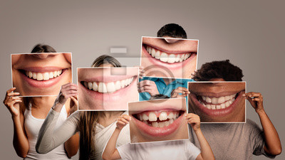 Naklejka group of happy people holding a picture of a mouth smiling on a gray background