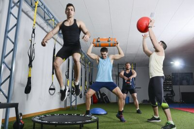 Naklejka Group of people in action doing crossfit exercises