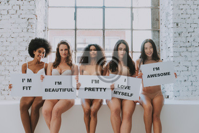 Naklejka Group of women with different body and ethnicity posing together to show the woman power and strength. Curvy and skinny kind of female body concept