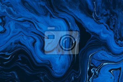 Naklejka Hand painted background with mixed liquid blue and golden paints. Classic blue color of the year 2020. Abstract fluid acrylic painting. Marbled blue abstract background. Liquid marble pattern
