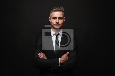Naklejka Handsome confident businessman wearing suit