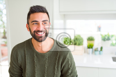 Naklejka Handsome man smiling cheerful with a big smile on face showing teeth, positive and happy expression
