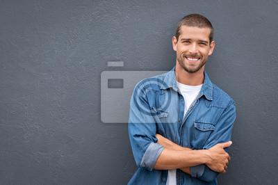 Naklejka Handsome young man smiling