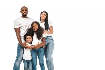 Naklejka happy african american parents with daughter and son smiling at camera while standing isolated on white