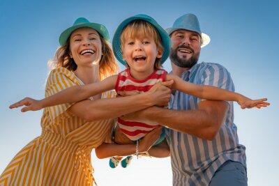 Naklejka Happy family having fun on summer vacation