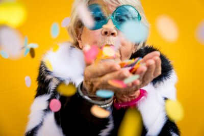 Naklejka Happy grandmother posing on colored backgrounds