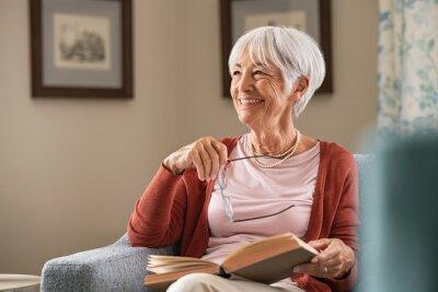 Naklejka Happy senior woman smiling at home