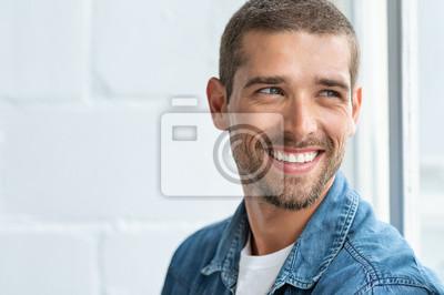 Naklejka Happy smiling man looking away