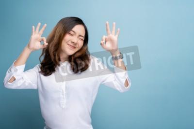 Naklejka Happy woman showing OK gesture isolated on background