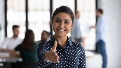 Naklejka Head shot of friendly indian boss greeting client stretch out hand welcoming express amity good manners meet job vacancy applicant, first acquaintance, human resource HR manager recruiter work concept