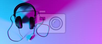 Naklejka headphones on a black background close-up in neon light