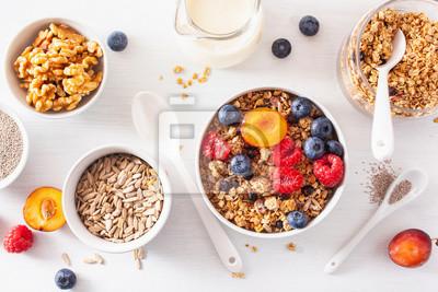 Naklejka healthy granola for breakfast with berry fruit nut, vegan milk