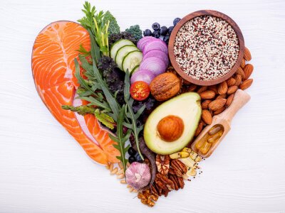Naklejka Heart shape of ketogenic low carbs diet concept. Ingredients for healthy foods selection on white wooden background. Balanced healthy ingredients of unsaturated fats for the heart and blood vessels.