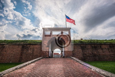 Naklejka Historic American flying over the entrance to Fort McHenry National Monument, Baltimore, Maryland