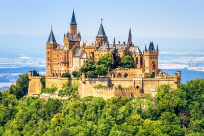 Naklejka Hohenzollern Castle close-up, Germany. This fairytale castle is famous landmark near Stuttgart. Scenic view of mount Burg Hohenzollern in forest. Scenery of Swabian Alps with Gothic castle in summer.