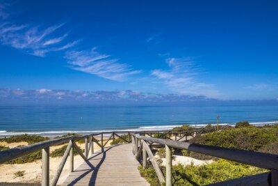 Naklejka Holzsteg w Andalusien Führt am Meer zum Strand