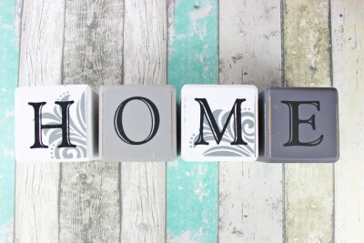 Naklejka Home sign on a distressed wooden background with turquoise tones