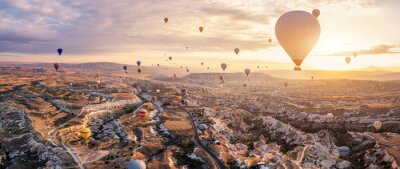 Naklejka Hot air balloons flying above Göreme, Cappadocia (Kapadokya) Anatolia, Turkey at sunrise. Panoramic view of villages and fairy chimneys. Popular touristic destination for summer vacation holidays
