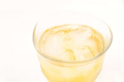 Naklejka Ice lemon tea on white background