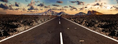 Naklejka Image related to unexplored road journeys and adventures.Road through the scenic landscape to the destination in Lanzarote natural park