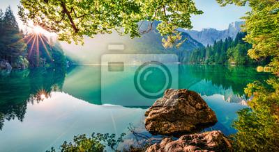 Naklejka Impressive morning view of Fusine lake. Attractive summer scene of Julian Alps with Mangart peak on background, Province of Udine, Italy, Europe. Traveling concept background.