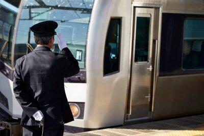 Naklejka Japanese train conductor at station