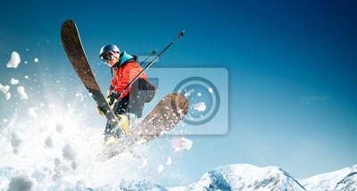 Naklejka Jazda na nartach. Skaczący narciarz. Ekstremalne sporty zimowe.