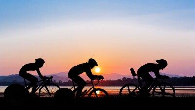 Naklejka Jazda na rowerze na czas zmierzchu