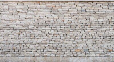 Naklejka kamienny mur wykonany z małych cegieł wapiennych