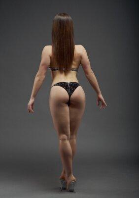 Naklejka Kobieta atletyczna budowa ciała.