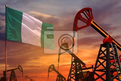 Naklejka Koncepcja przemysłu naftowego Nigerii. Ilustracja przemysłowe - Nigeria flaga i szybów naftowych z czerwonym i niebieskim tle zachodu słońca lub nieba - ilustracja 3D