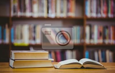 Naklejka Książki na biurku w bibliotece