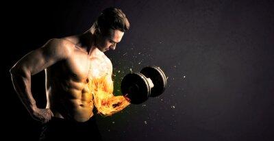Naklejka Kulturysta zawodnik podnoszenia ciężaru z ogniem eksplodować koncepcji ramię