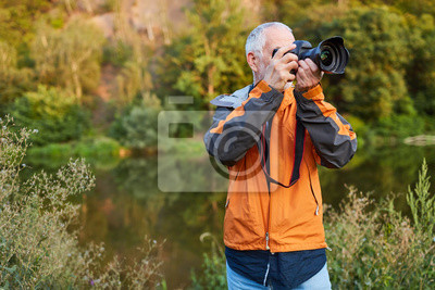 Naklejka Landscape photographer in nature while photographing