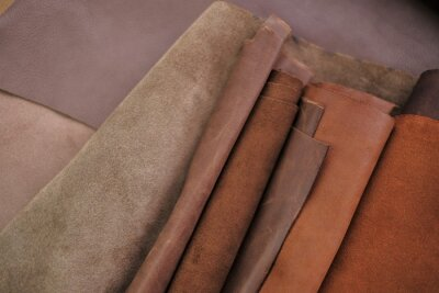 Naklejka  Leather pieces set .  Genuine leather in brown and gray colors.Leather industry. Hobby and craft material.Leather goods material.material for the production clothing and footwear