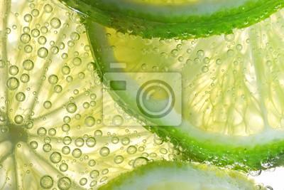 Naklejka Lemon Slices In Water With Bubbles