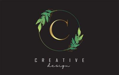 Naklejka Letter C logo design with uppercase, leaf details, golden outline leaves and circle frame. Vector Illustration with Botanical elements.