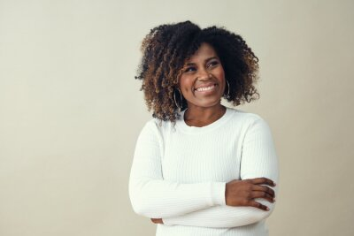 Naklejka Looking up at copy space African American Smiling Woman Wearing a white sweater