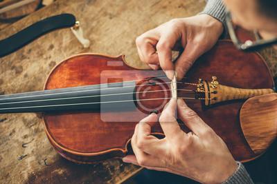 Naklejka Luthier repair violin in his workshop