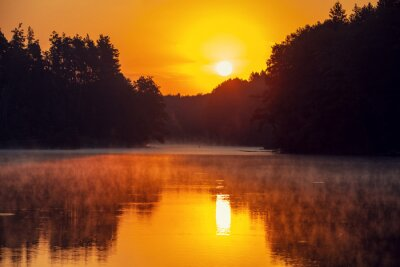 Magical golden sunset over the lake. Serene lake in the evening. Nature landscape
