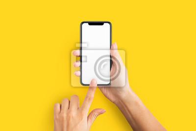 Naklejka Makieta żeńskiej ręki trzymającej telefon komórkowy z pustego ekranu