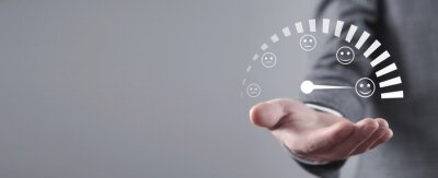 Naklejka Male hand holding customer emotions satisfaction meter.
