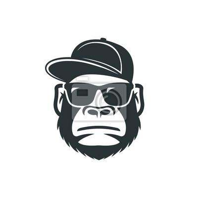 Naklejka Małpa w okularach przeciwsłonecznych i czapce. Ikona fajny goryl