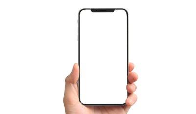 Naklejka Man hand holding smartphone device touching screen