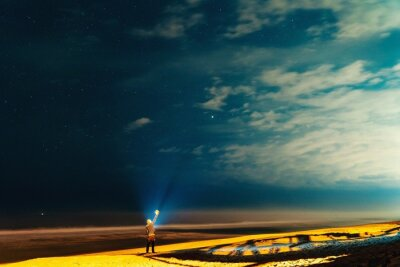 Naklejka Man Standing On Field Against Sky At Night