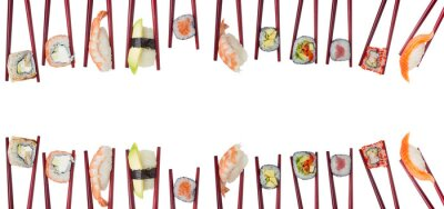 Naklejka Many different sushi and rolls in chopsticks isolated on white background