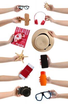 Naklejka Many hands with travel items on white background