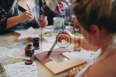 Naklejka master class on creativity. girl makes a frame